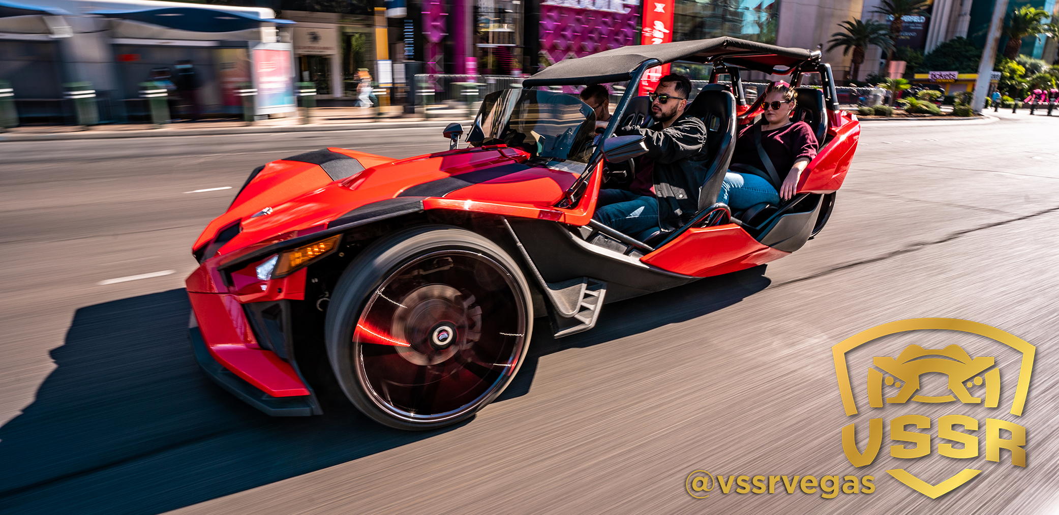 vssr 4 seater slingshot strip with passengers with logo